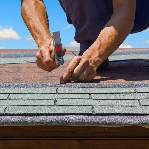 Roof Repair With Nail & Hammer